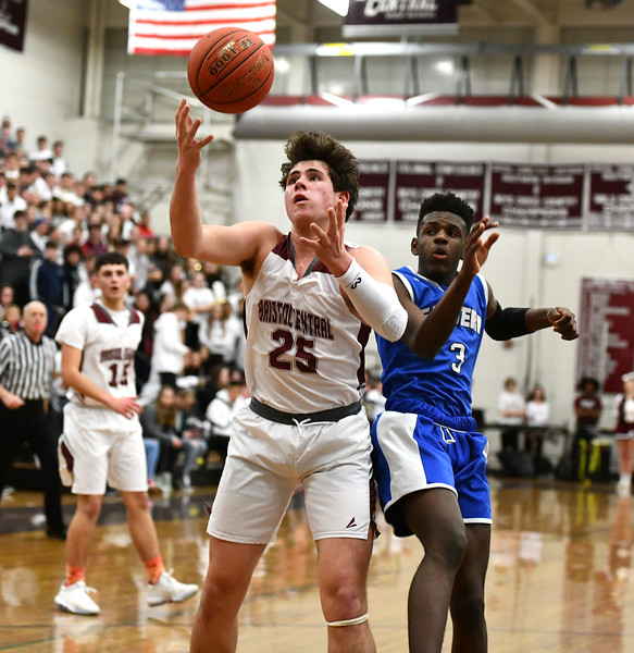 1/24/2020 Mike Orazzi | Staff Bristol Central High School's Sean Wininger (25) and Bristol Eastern's Elijah Borgelin (3) during Friday night's boys basketball game at Central.