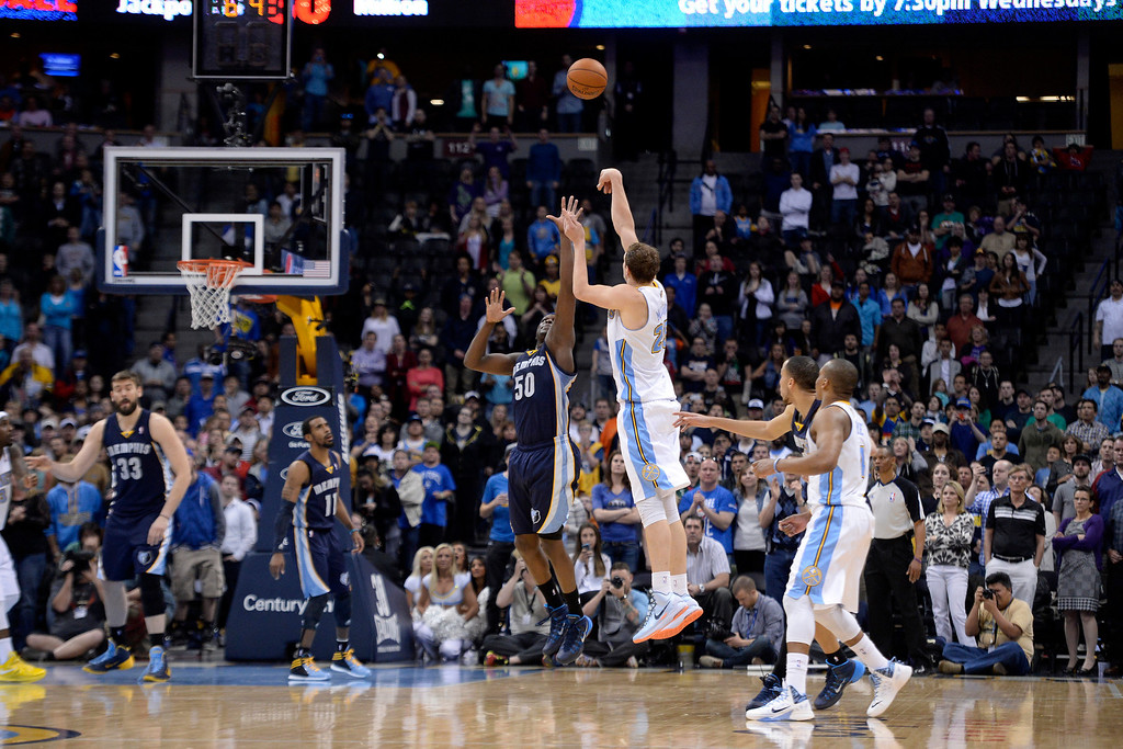 . Denver Nuggets center Timofey Mozgov (25) attempts a game-tying three pointer over Memphis Grizzlies forward Zach Randolph (50) during the fourth quarter of the Grizzlies\' 94-92 win. (Photo by AAron Ontiveroz/The Denver Post)