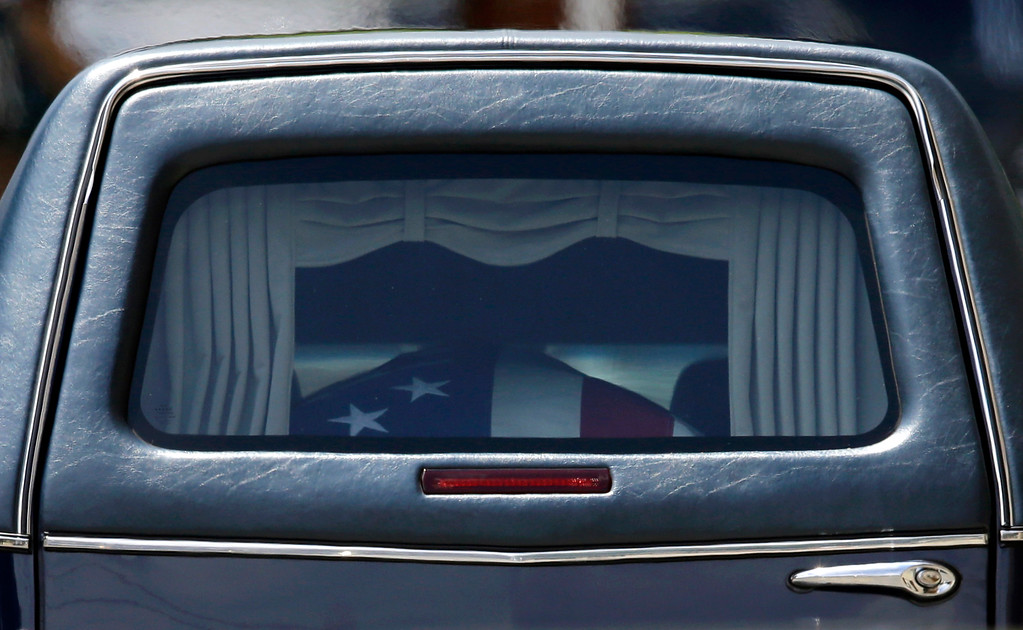 . A hearse carries a casket containing the remains of Vice President Joe Biden\'s son, former Delaware Attorney General Beau Biden after funeral service, Saturday, June 6, 2015, at St. Anthony of Padua Roman Catholic Church in Wilmington, Del. Biden, the eldest son of the vice president, died of brain cancer May 30 at age 46. (AP Photo/Patrick Semansky)