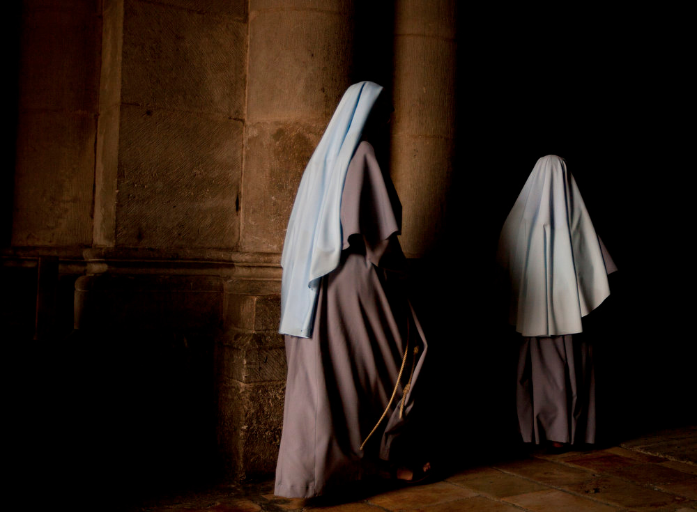 Description of . Nuns walk during the Sunday Easter mass at the Church of the Holy Sepulcher, traditionally believed to be the site of the crucifixion of Christ, in Jerusalem's Old City, Sunday, March 31, 2013. (AP Photo/Sebastian Scheiner)