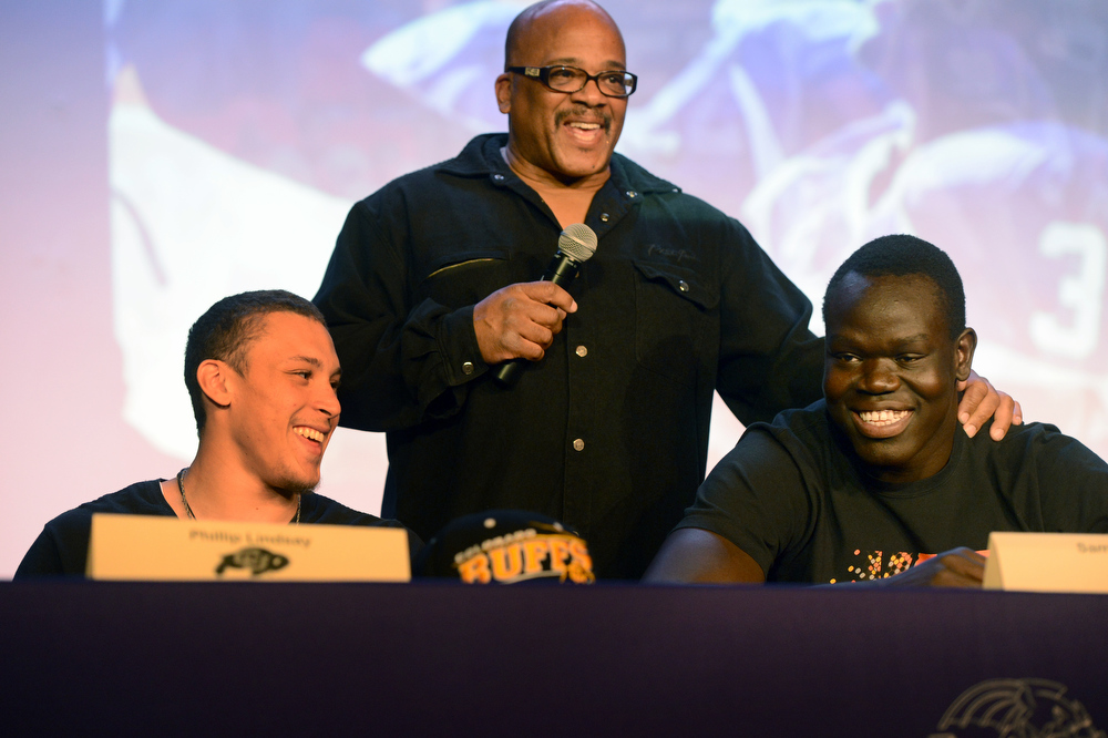 . Denver South High School football coach Tony Lindsay Sr. introduces players Phillip Lindsay, left, and Samuel Mabany during a signing day ceremony at the school in Denver, CO February  06, 2013. Phillip Lindsay signed with the University of Colorado and Mabany signed with the University of New Mexico. (Photo By Craig F. Walker/The Denver Post)