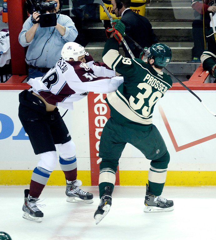 . Patrick Bordeleau tussled with Nate Prosser in the first period.   (Photo by Karl Gehring/The Denver Post)
