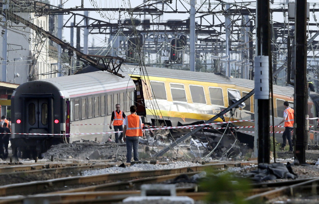 . Rescuers work on the site of a train accident in the railway station of Bretigny-sur-Orge on July 12, 2013 near Paris. At least seven people were dead and dozens injured after a speeding train split in two and derailed at a station in the southern suburbs of Paris, officials said. AFP PHOTO /KENZO TRIBOUILLARD/AFP/Getty Images