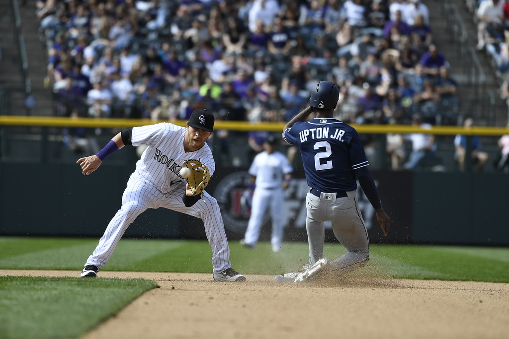 . Melvin Upton Jr. (2) of the San Diego Padres steals second base as Trevor Story (27) of the Colorado Rockies makes the catch during the fourth inning. The Colorado Rockies played the San Diego Padres Friday, April 8, 2016 on opening day at Coors Field in Denver, Colorado. (Photo By Andy Cross/The Denver Post)