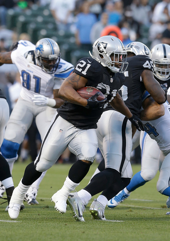 . Oakland Raiders running back Maurice Jones-Drew (21) runs against the Detroit Lions during the first quarter of an NFL preseason football game in Oakland, Calif., Friday, Aug. 15, 2014. (AP Photo/Jeff Chiu)