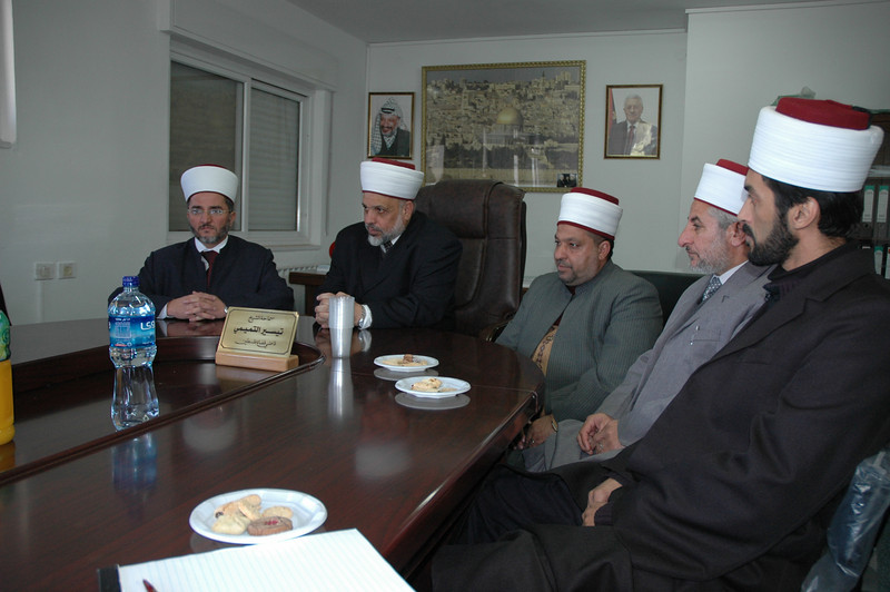 Palestine Muslim leaders, led by Sheikh Al-Tamini, second from left, supreme judge of the Islamic courts, Palestine, met with a small group of North American Lutheran bishops Jan. 13 in Ramallah.