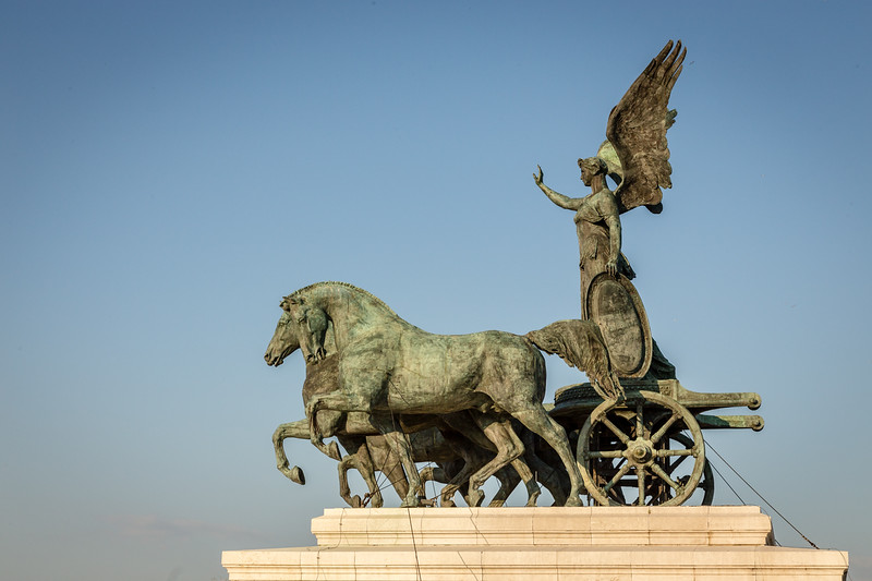 statue of winged warrior on chariot