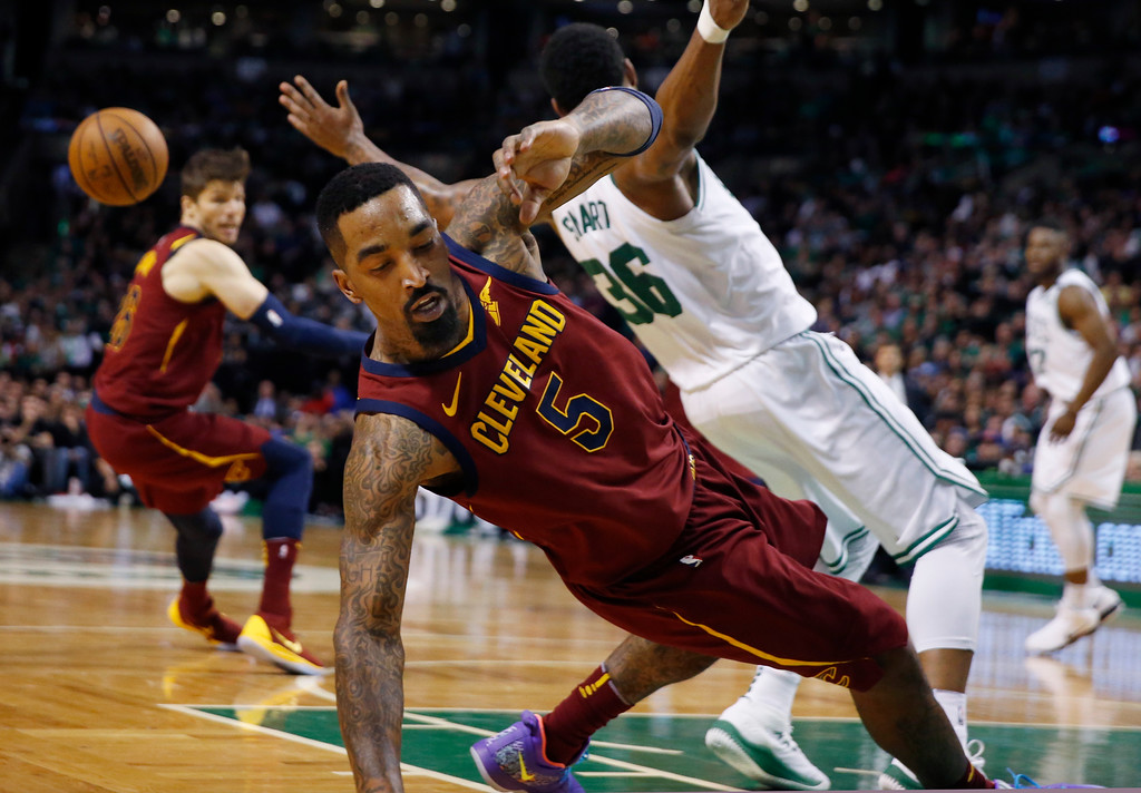 . Cleveland Cavaliers guard JR Smith (5) and Boston Celtics guard Marcus Smart (36) get entangled during the second quarter of Game 1 of the NBA basketball Eastern Conference Finals, Sunday, May 13, 2018, in Boston. (AP Photo/Michael Dwyer)