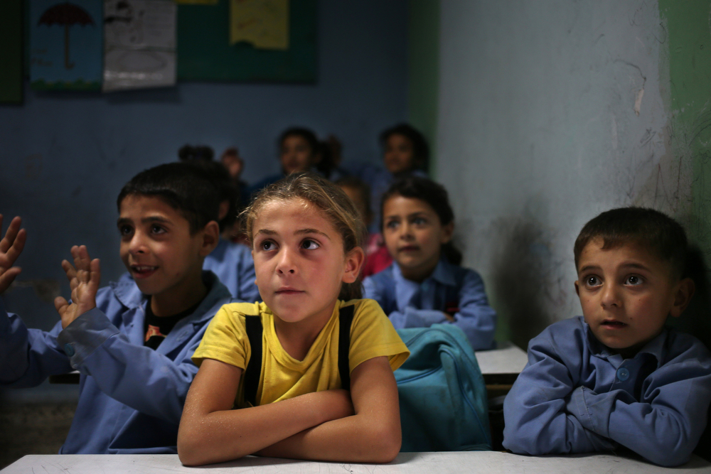 . In this picture taken on Thursday, May 29, 2014, Syrian refugee students sit in their classroom at a Lebanese public school where only Syrian students attend classes in the afternoon, in Kaitaa village in north Lebanon. (AP Photo/Hussein Malla)