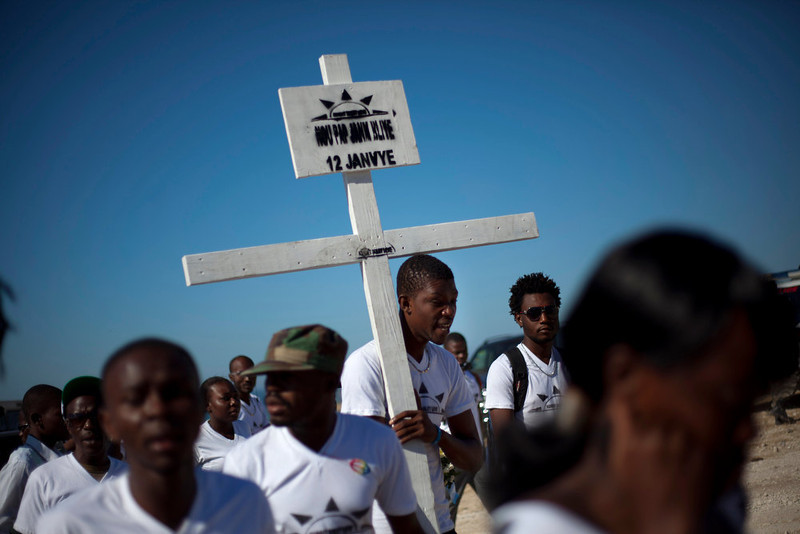 . Relatives of those who died in the 2010 earthquake arrive for a memorial service at Titanyen, a mass burial site north of Port-au-Prince, Haiti, Saturday, Jan. 12, 2013. Haitians recalled the tens of thousands of people who lost their lives in a devastating earthquake three years ago, marking the disaster\'s anniversary Saturday with a simple ceremony. Haiti\'s previous presidential administration said 316,000 people were killed but no one really knows how many died.  (AP Photo/Dieu Nalio Chery)