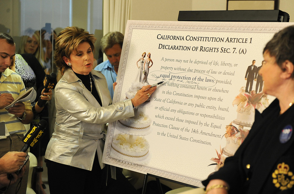 ". Attorney Gloria Allred writes in the phrase ""except for gays and lesbians\"" on a posterboard showing a portion of the California Constitution Declaration of Rights, after hearing the California Supreme Court decision to uphold Prop 8, a voter-approved ban on same-sex marriage, during a press conference at Allred\'s offices in Los Angeles on May 26, 2009.   The 18,000 gay couples who wed in the brief time same-sex marriage was legal last year will stay married, but no new same-sex marriages will be permitted. ROBYN BECK/AFP/Getty Images"
