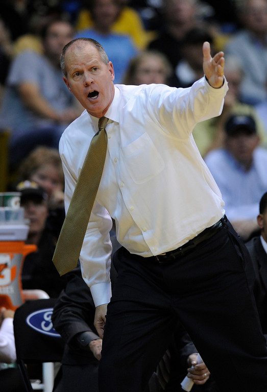 . Buffs coach Tad Boyle made a point with his players in the second half. The University of Colorado men\'s basketball team defeated Colorado State University 70-61 at the Coors Events Center Wednesday night, November 5, 2012. Karl Gehring/The Denver Post