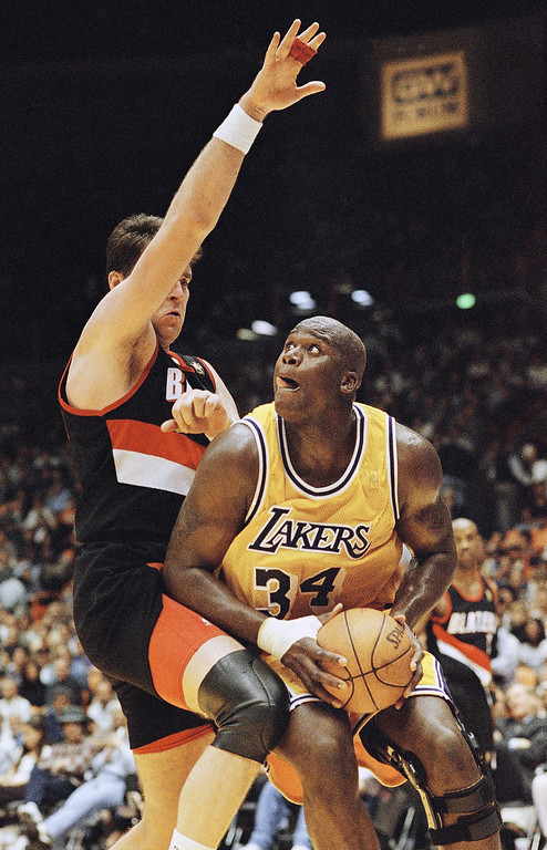 . Los Angeles Lakers Shaquille O?Neal looks to score as Portland Trail Blazer Arvydas Sabonis tries to block him, April 25, 1997 during the second half at the Forum in Inglewood, Calif. O?Neal had a career playoff high of 46 points for the 95-77 win over the Trail Blazers. (AP Photo/Mark J. Terrill)