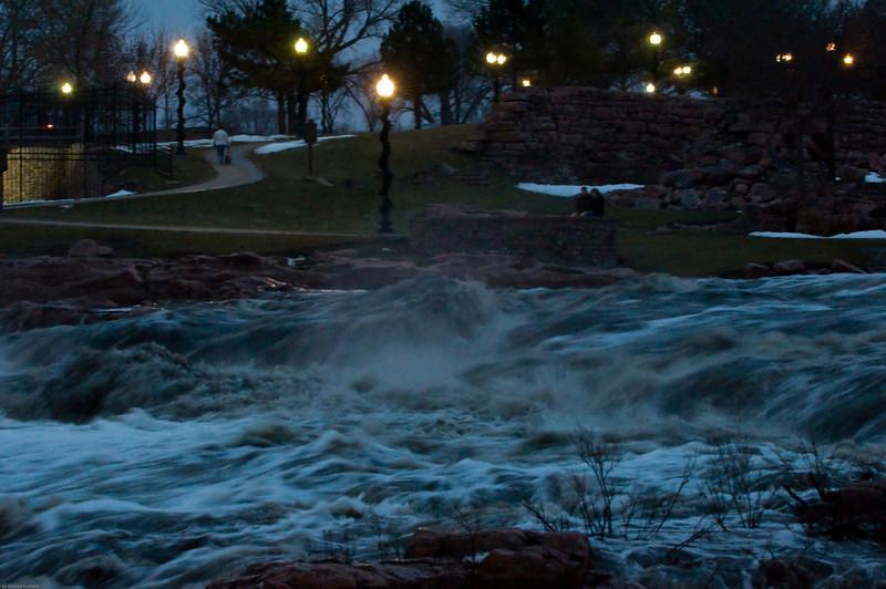 The surmount of water flow through the Falls park.