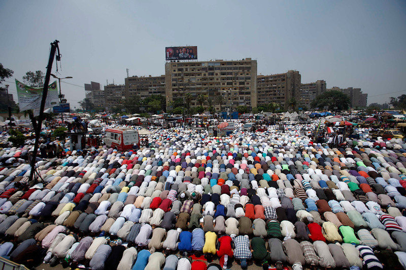 . Supporters of Egyptian President Mohamed Mursi perform prayers during a protest to show support to him at the Raba El-Adwyia mosque square in Cairo July 3, 2013. At least 16 people were killed on Wednesday and 200 wounded when gunmen opened fire on supporters of President Mohamed Mursi who were rallying outside Cairo University, state television quoted a Health Ministry spokesman as saying. REUTERS/Khaled Abdullah