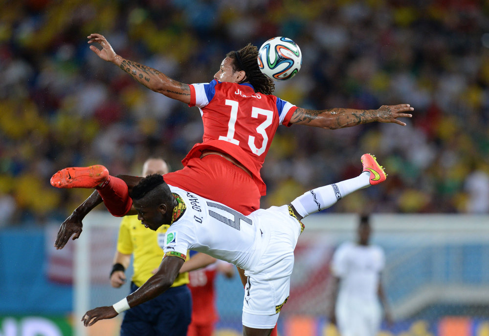 Description of . US midfielder Jermaine Jones  (L) vies with Ghana's defender Daniel Opare (R) during a Group G football match between Ghana and US at the Dunas Arena in Natal during the 2014 FIFA World Cup on June 16, 2014.  CARL DE SOUZA/AFP/Getty Images