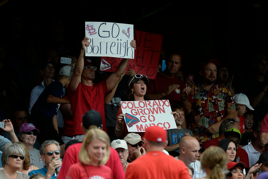 . Family and friends hold up signs as they watch St. Louis Cardinals starting pitcher Marco Gonzales (56) make his major league debut against the Colorado Rockies June 25, 2014 at Coors Field. (Photo by John Leyba/The Denver Post)