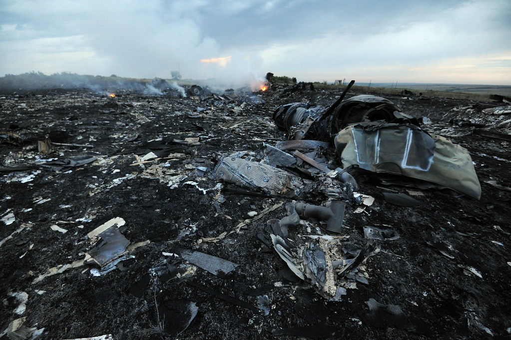 . A picture taken on July 17, 2014 shows flames amongst the wreckages of the malaysian airliner carrying 295 people from Amsterdam to Kuala Lumpur after it crashed, near the town of Shaktarsk, in rebel-held east Ukraine. Pro-Russian rebels fighting central Kiev authorities claimed on Thursday that the Malaysian airline that crashed in Ukraine had been shot down by a Ukrainian jet. AFP PHOTO/DOMINIQUE  FAGET/AFP/Getty Images