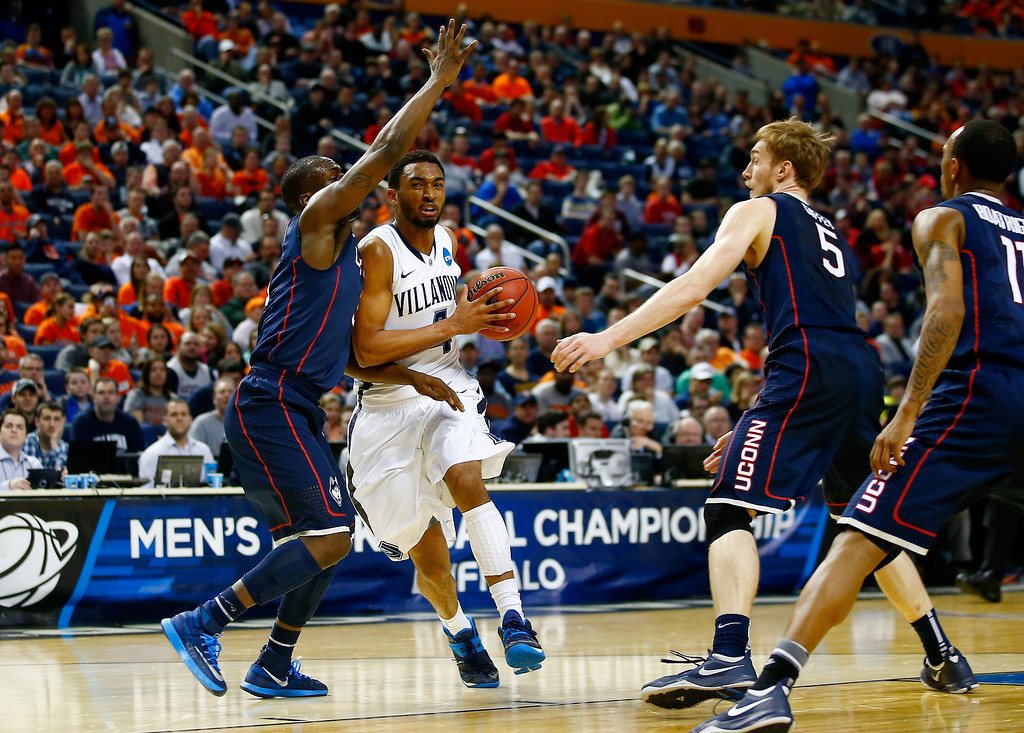 . BUFFALO, NY - MARCH 22: Darrun Hilliard II #4 of the Villanova Wildcats drives to the basket against the Connecticut Huskies during the third round of the 2014 NCAA Men\'s Basketball Tournament at the First Niagara Center on March 22, 2014 in Buffalo, New York.  (Photo by Jared Wickerham/Getty Images)