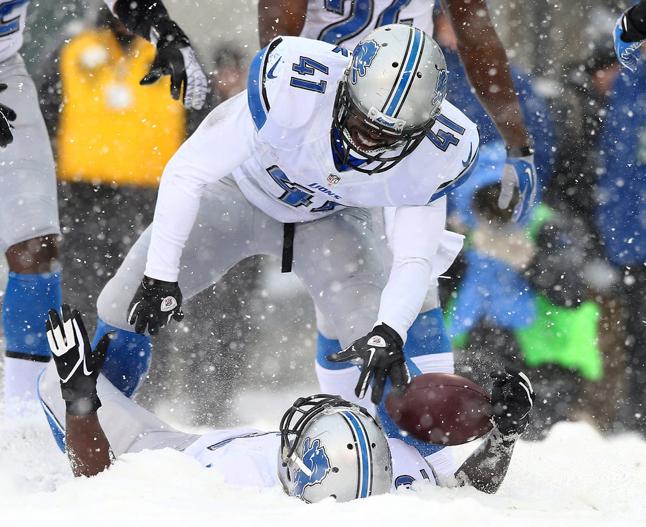 . Jeremy Ross #12 of the Detroit Lions celebrates his touchdown with teammate Theo Riddick #41 in the third quarter against the Philadelphia Eagles on December 8, 2013 at Lincoln Financial Field in Philadelphia, Pennslyvania.  (Photo by Elsa/Getty Images)