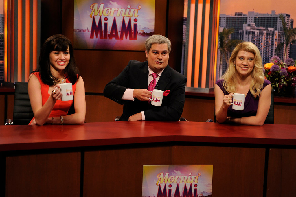 """. Guest host Miley Cyrus, from left, Bobby Moynihan and Kate McKinnon in a scene from the late-night comedy series \""""Saturday Night Live,\"""" in New York on Oct. 5, 2013. (AP Photo/NBC, Dana Edelson)"""