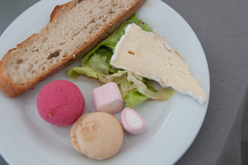 Desserts are Very different from the gooey fruit pies and cakes we usually have.  Bread Brie cheese, French Macrons.  Yes, that's how it's spelled ( the hot pink and beige one), were divine and very light. The little pink and white marsh mellows had a tart and tasty outer covering.