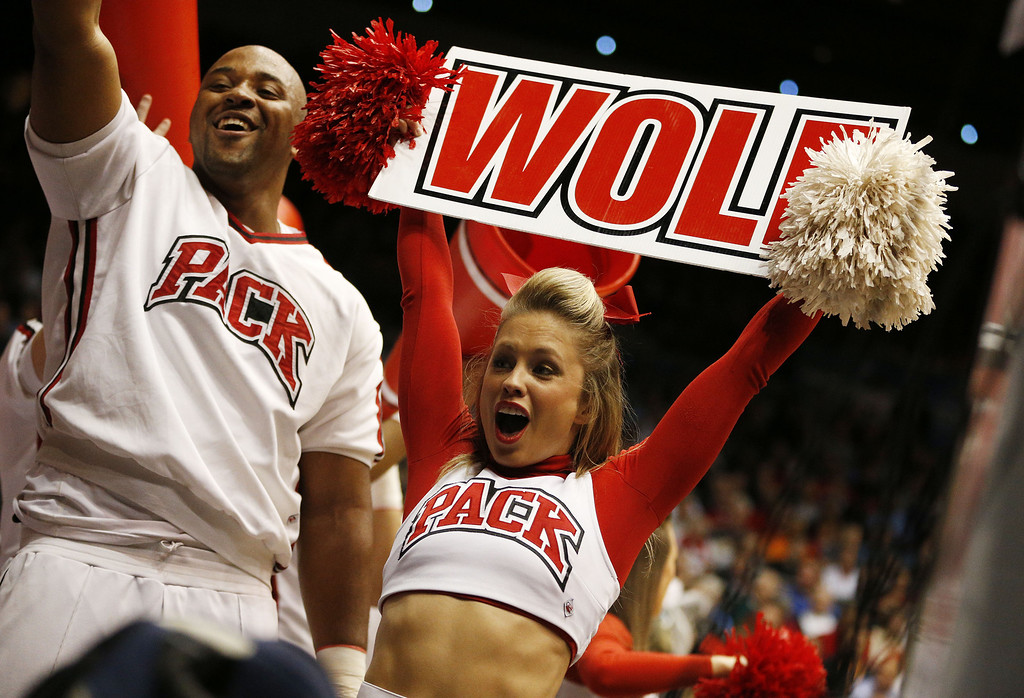 . North Carolina State Wolfpack cheerleaders perform in the first half against the Xavier Musketeers during the first round of the 2014 NCAA Men\'s Basketball Tournament at at University of Dayton Arena on March 18, 2014 in Dayton, Ohio.  (Photo by Gregory Shamus/Getty Images)