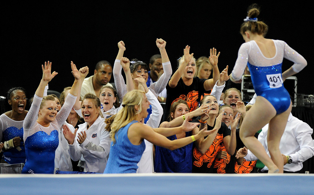 . Florida cheers floor exercise by Bridgette Caquatto at the NCAA Women\'s Gymnastics Championship Team Finals at Pauley Pavilion, Saturday, April 20, 2013. (Michael Owen Baker/Staff Photographer)