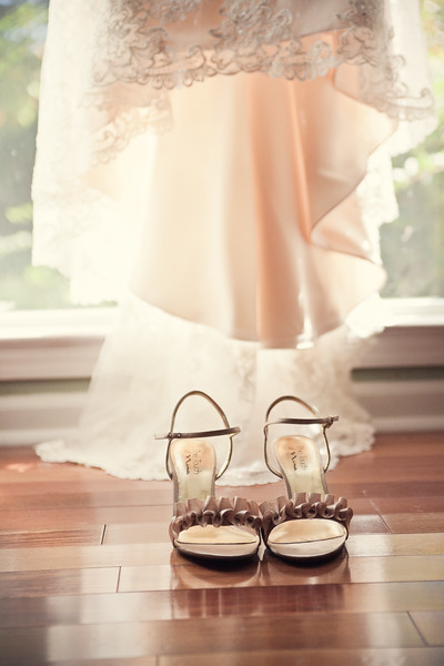 bridal shoes in front of window