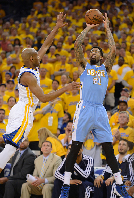 . Wilson Chandler (21) of the Denver Nuggets takes a shot over Jarrett Jack (2) of the Golden State Warriors during the second quarter in Game 6 of the first round NBA Playoffs May 2, 2013 at Oracle Arena. (Photo By John Leyba/The Denver Post)
