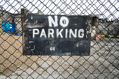 No parking sign on a fence, Hackney, London, United Kingdom