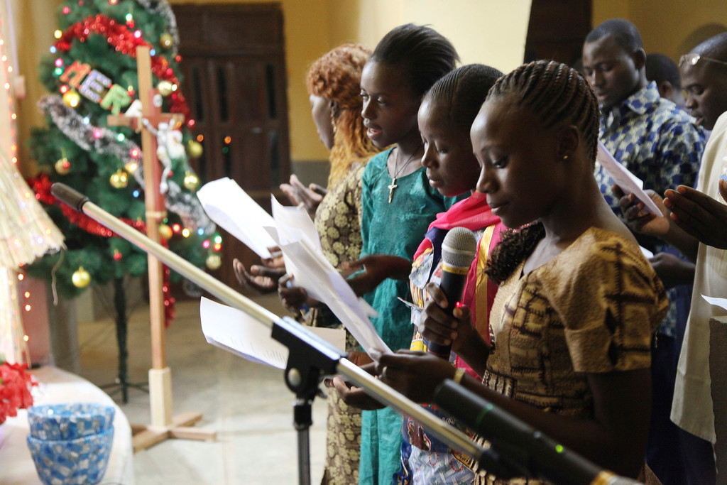 . In this photo taken Saturday, Dec. 24, 2016, Catholic faithfuls sing during a mass to celebrate Christmas at Philippe Amore Catholic Church in Goa, Mali. Just four years ago strict Islamic law was in force in this town, but Christians have returned to rebuild their congregation that fled the jihadist occupation. (AP Photo/Baba Ahmed)