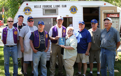 """The Belle Fourche Lions Club was again recipient of the best """"Club Website"""" in MD5.  District 5-SW Governor Janice Wagner (center) showed up at the event to present the award to webmaster Lion Larry Miller.  Other Lions (l-r) are Brian Kline, Tom Nary, Rick Walton, President Rik Bartels, Larry Miller, Jan Wagner, Ron Ensz, Gerald Keil and Rich Drabek."""