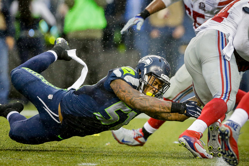 . Seattle Seahawks outside linebacker Bruce Irvin tackles New York Giants running back Andre Williams for a 2-yard loss in the second half of an NFL football game, Sunday, Nov. 9, 2014, in Seattle. (AP Photo/Scott Eklund)