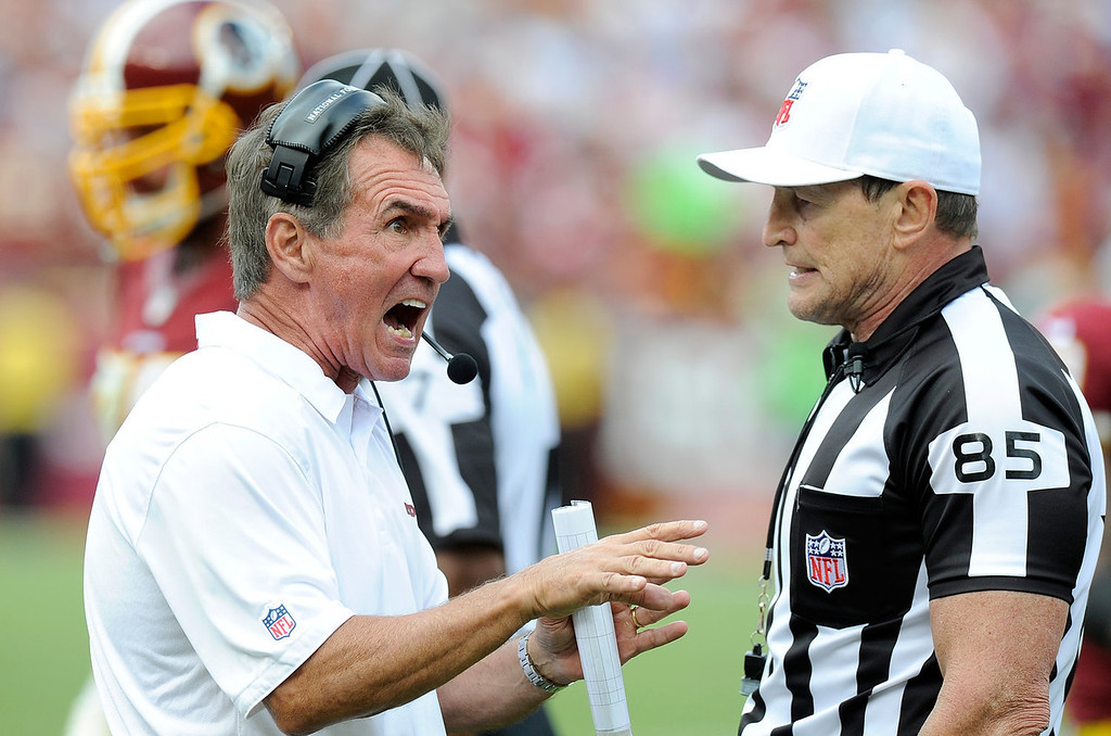 . Head coach Mike Shanahan of the Washington Redskins argues a call with referee Ed Hochuli #85 in the fourth quarter against the Detroit Lions at FedExField on September 22, 2013 in Landover, Maryland.  (Photo by Greg Fiume/Getty Images)