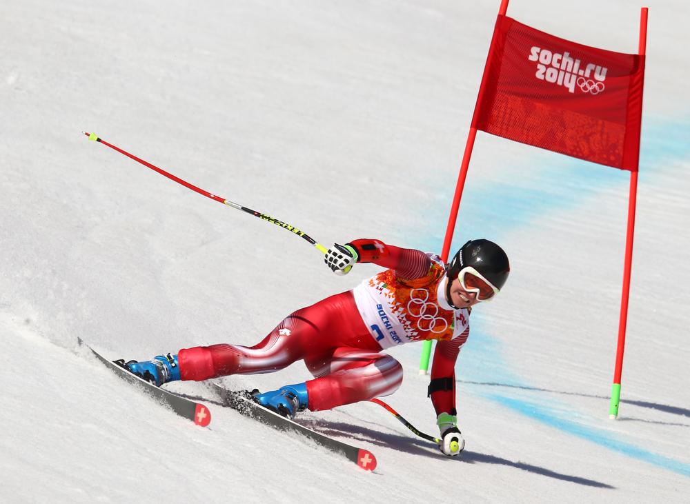 . Switzerland\'s Fabienne Suter passes a gate in the women\'s super-G at the Sochi 2014 Winter Olympics, Saturday, Feb. 15, 2014, in Krasnaya Polyana, Russia. (AP Photo/Alessandro Trovati)