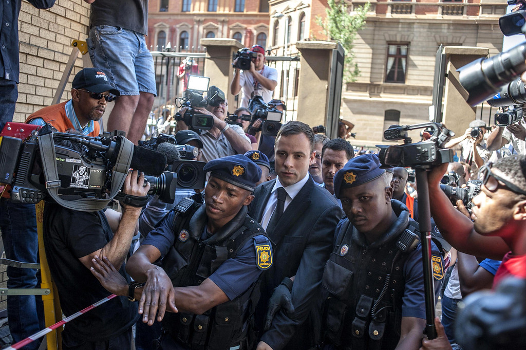 . South African Paralympic athlete Oscar Pistorius arrives at the High Court in Pretoria on October 21, 2014. AFP PHOTO/POOL /  IHSAAN HAFFEJEE/AFP/Getty Images