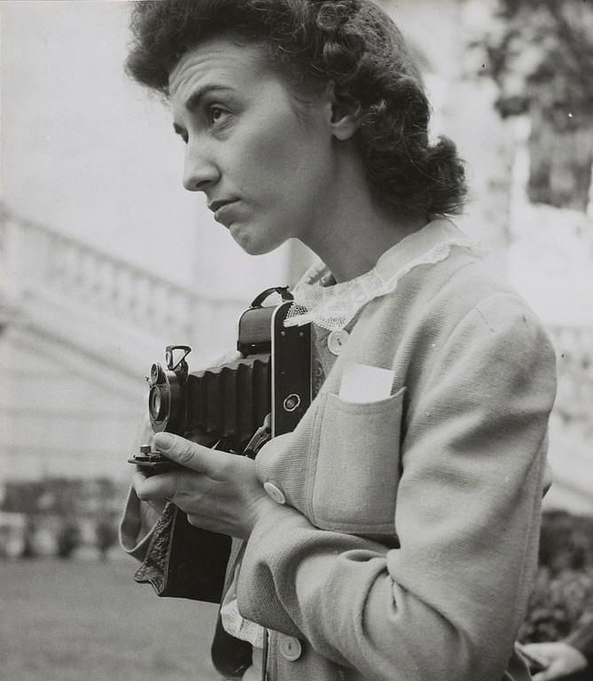 . Arlington Cemetery, Arlington, Virginia. A girl taking a picture of the ceremony of laying a wreath on the Tomb of the Unknown Soldier. Esther Bubley, Photographer.  Courtesy the Library of Congress