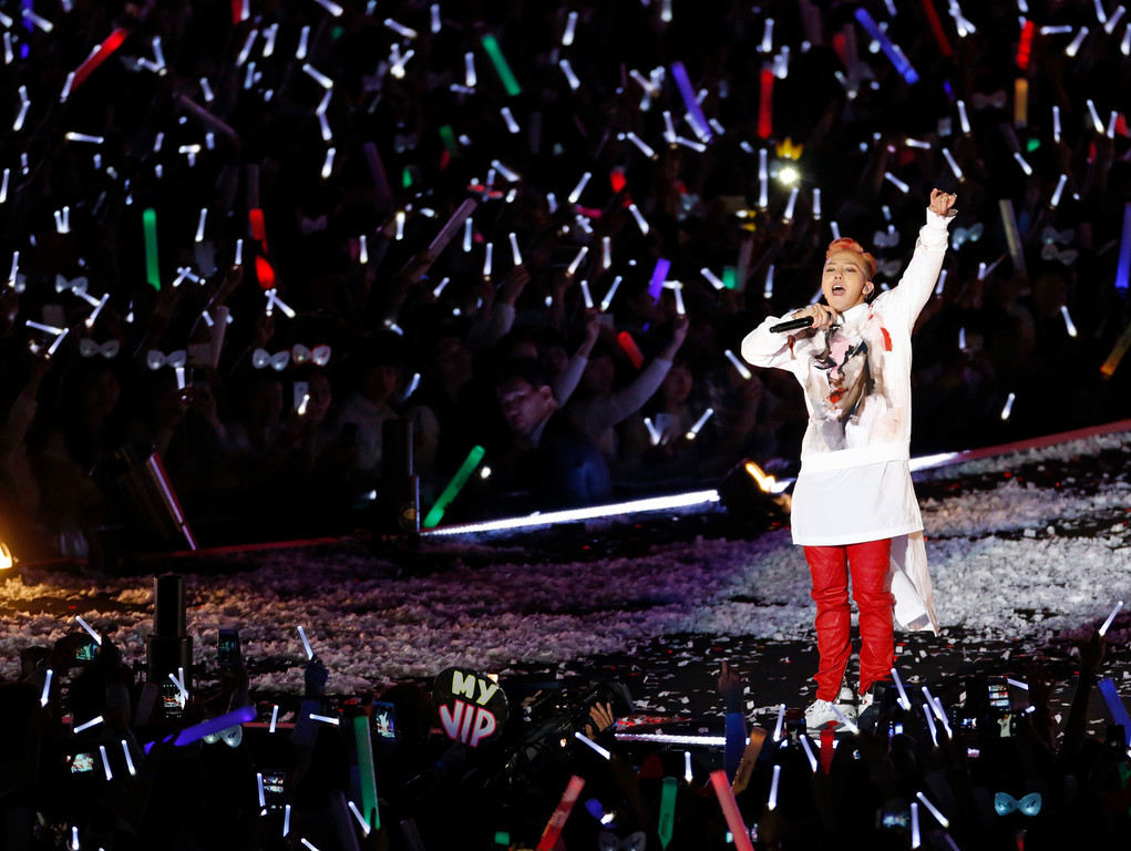 """. K-pop singer G-Dragon performs as a guest during Psy\'s concert \""""Happening\"""" in Seoul April 13, 2013. Psy performed his new song \""""Gentleman\"""" in public for the first time on Saturday at the concert at Seoul\'s World Cup stadium.  REUTERS/Lee Jae-Won"""