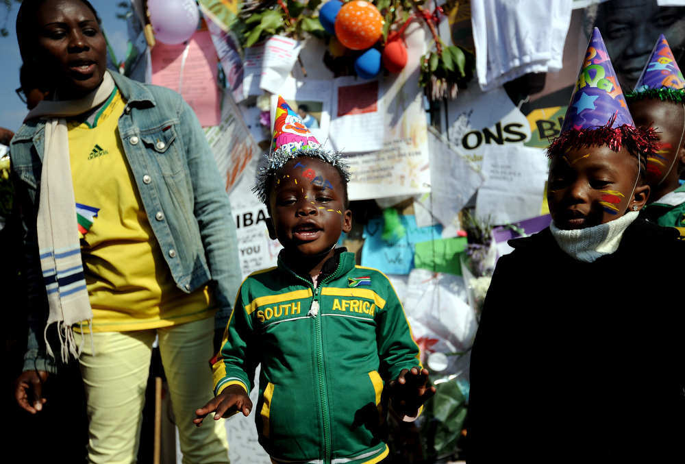 """. Schoolchildren sing to wish an happy birthday to former South African President Nelson Mandela on July 18, 2013 outside the Medi Clinic Heart Hospital in Pretoria. Mandela\'s health is \""""steadily improving\"""", South Africa\'s presidency said on July 18 as the anti-apartheid legend began spending his 95th birthday in hospital. Children in schools around the country kicked off the celebrations by singing \""""Happy Birthday\"""" to Mandela, on a day that also marked the 15th anniversary of his marriage to third wife Graca Machel.The United Nations declared the Nobel Peace laureate\'s birthday Mandela Day in 2010, but for many this year it takes on extra poignancy.  STEPHANE DE SAKUTIN/AFP/Getty Images"""