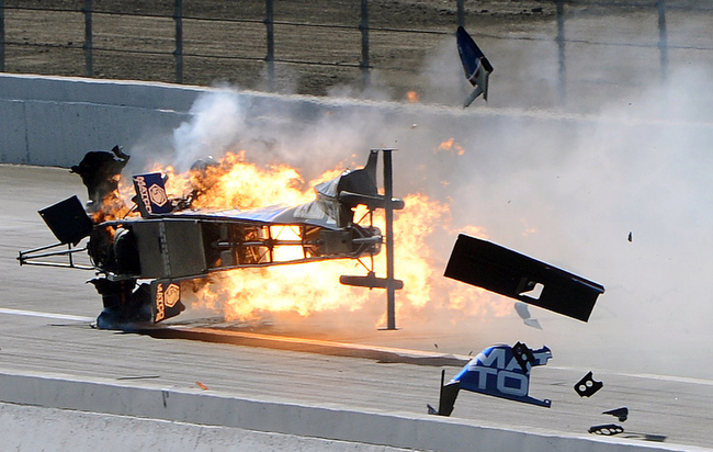 Description of . Top Fuel driver Antron Brown's dragster bursts into flames after crashing in the second round of eliminations at the NHRA Winternationals auto racing event, Sunday, Feb. 17, 2013, in Pomona, Calif. Brown walked away from the fiery crash with only minor injuries. (AP Photo/The Inland Valley Daily Bulletin, Will Lester)  MANDATORY CREDIT; MAGS OUT