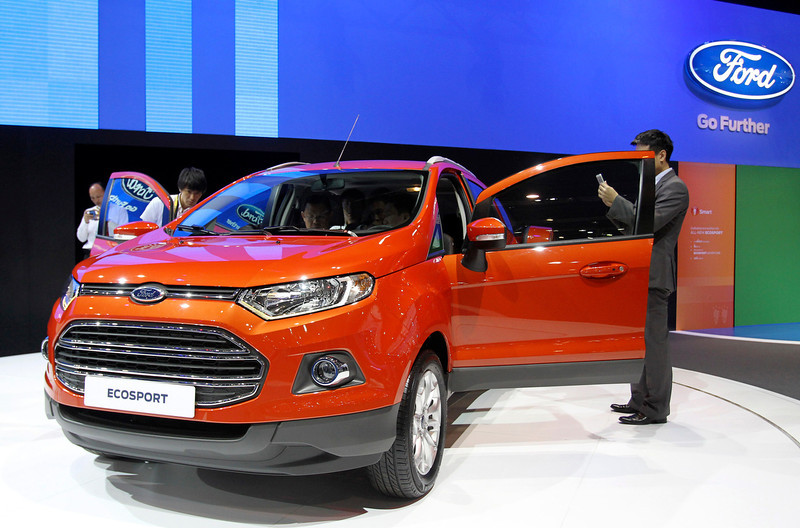 . Thai visitors inspect a new Ford EcoSport as the SUV is introduced in Southeast Asia for the first time on the press day of the Bangkok Motor Show in Bangkok, Thailand, Tuesday, March 26, 2013. The 34th running of the show is opened to the public from Wednesday. (AP Photo/Sakchai Lalit)