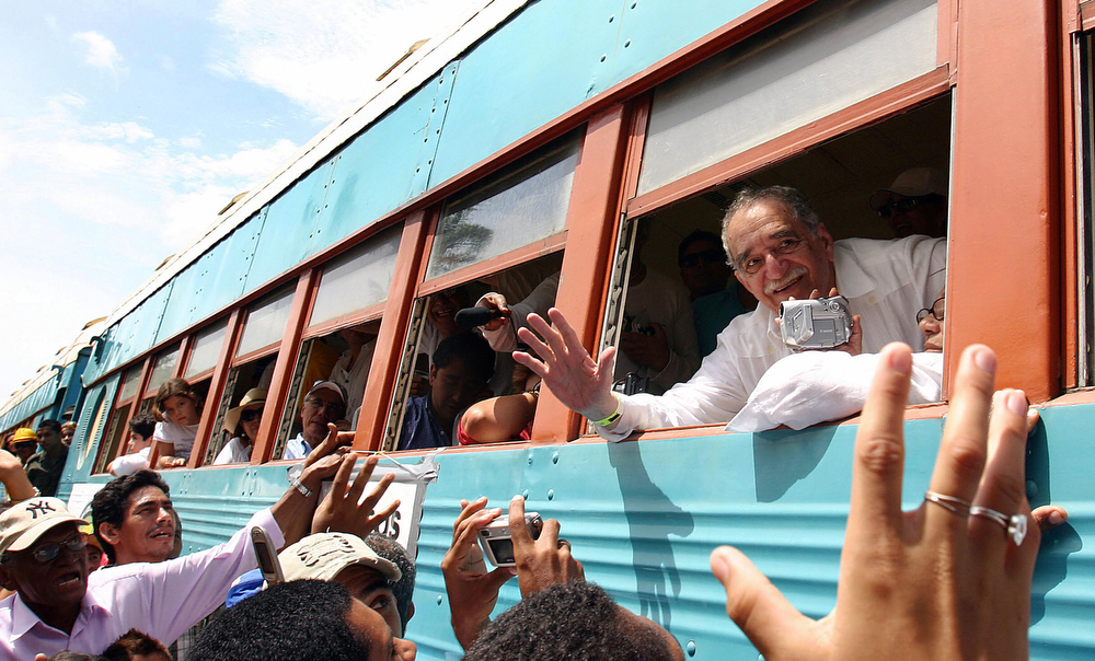 . Colombian Nobel Prize for Literature 1982 Gabriel Garcia Marquez (L) leans out of the window of the train upon arrival at his hometown Aracataca, Colombia 30 May, 2007. Garcia Marquez hadn\'t visited Aracataca in twenty years. AFP PHOTO/ Alejandra VEGA (ALEJANDRA VEGA/AFP/Getty Images)