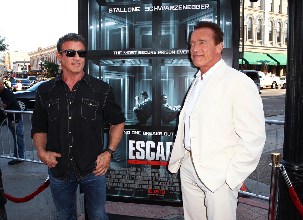 ". Actors Sylvester Stallone (L) and Arnold Schwarzenegger attends the ""Escape Plan\"" screening and red carpet during Comic-Con International 2013 at Reading Cinemas Gaslamp on July 18, 2013 in San Diego, California.  (Photo by Joe Scarnici/Getty Images for Summit Entertainment)"