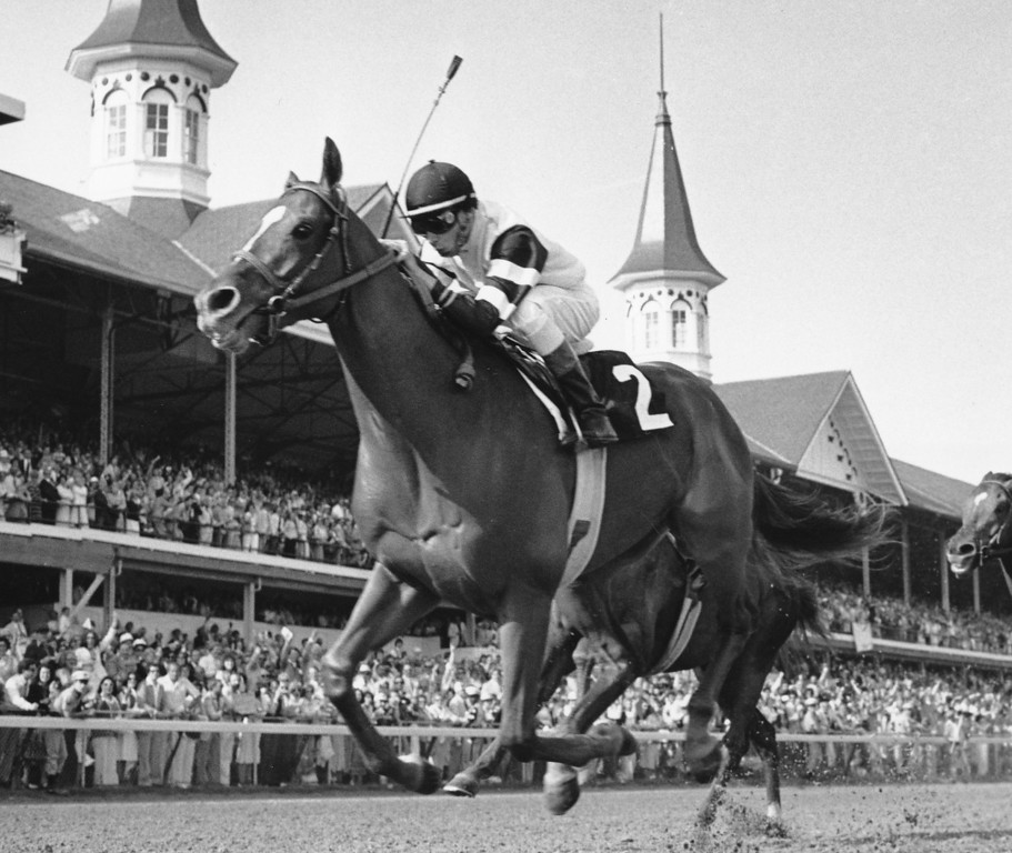 . 1978: AFFIRMED - Jockey Steve Cauthen rides Affirmed across the finish line to win the 104th running of the Kentucky Derby in Louisville, Ky. Affirmed went on to win the Triple Crown that year.   (AP Photo/File)