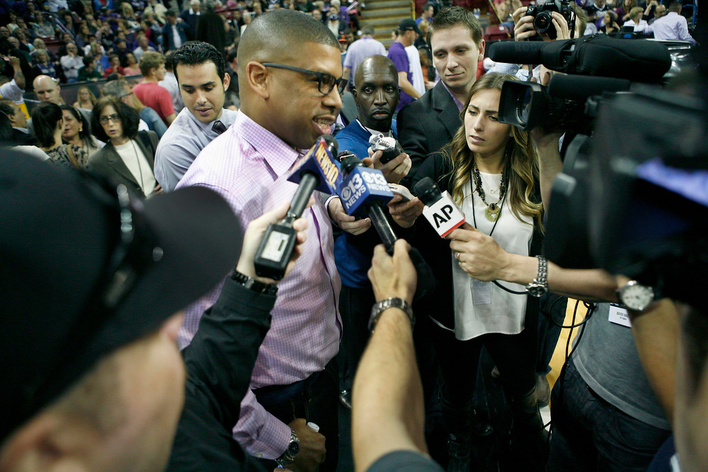 . Sacramento Mayor Kevin Johnson talks to reporters about the future of the Kings during half time of an NBA basketball game against the Los Angeles Clippers in Sacramento, Calif., on April 17, 2013.(AP Photo/Steve Yeater)