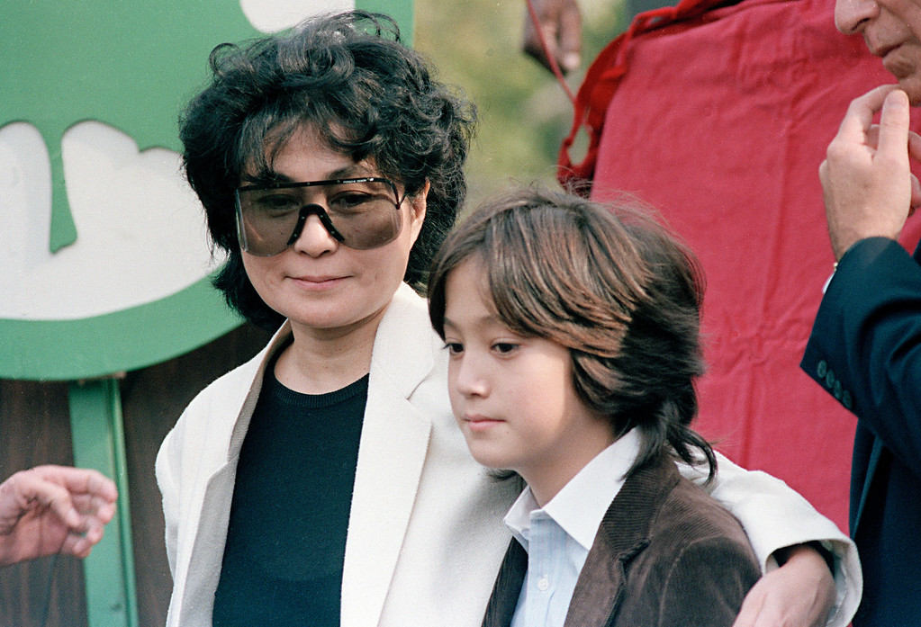 . Sean Lennon and his mother Yoko Ono are seen at the dedication of Strawberry Fields in memory of John Lennon, Oct. 9, 1985, in Central Park in New York. (AP Photo/G. Paul Burnett)