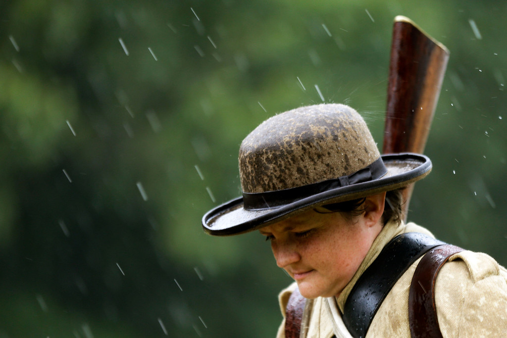 . A Confederate reenactor walks in rainstorm during ongoing activities commemorating the 150th anniversary of the Battle of Gettysburg, Thursday, June 27, 2013, in Gettysburg, Pa.. (AP Photo/Matt Rourke)