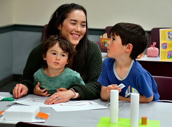 5/4/2019 Mike Orazzi | Staff Susanne Festa and her children Kayleb,3, and Luca,6, work on crafts during Star Wars day activities at the Bristol Public Library on Saturday.