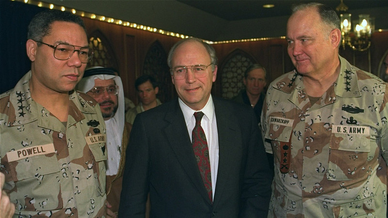 . Chairman of the Joint Chiefs of Staff Gen. Colin Powell, left, Defense Secretary Dick Cheney, center, and Gen. H. Norman Schwarzkopf come together at the end of a military briefing in Riyadh, Sunday morning, Feb. 10, 1991.  Cheney and Powell wind up a three-day trip to Saudi Arabia today. (AP Photo/Tannen Maury)